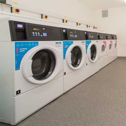 laundry room showing washers and dryers